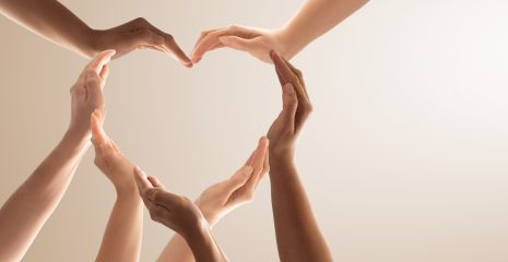 Heart shaped hands representing community support